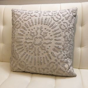 Accent pillow with sequin embroidered accents